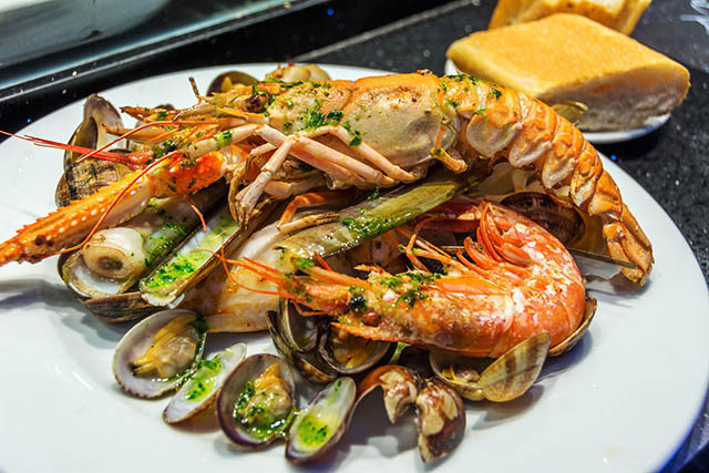 A plate of assorted seafood and shellfish.