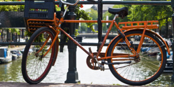 Orange bike on the canal