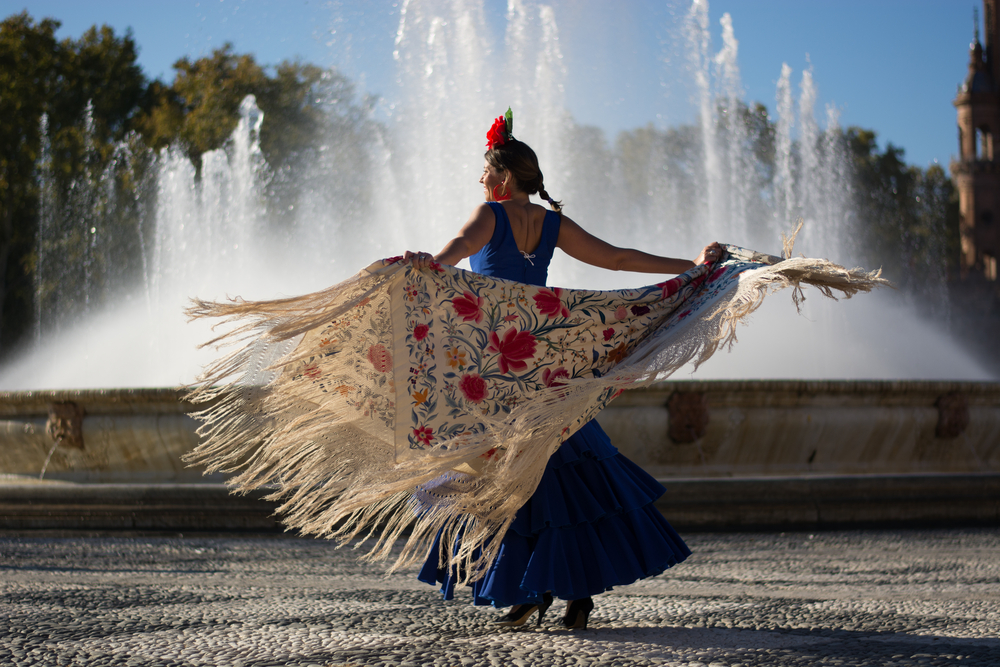 Flamenco dancing in front of a fountain