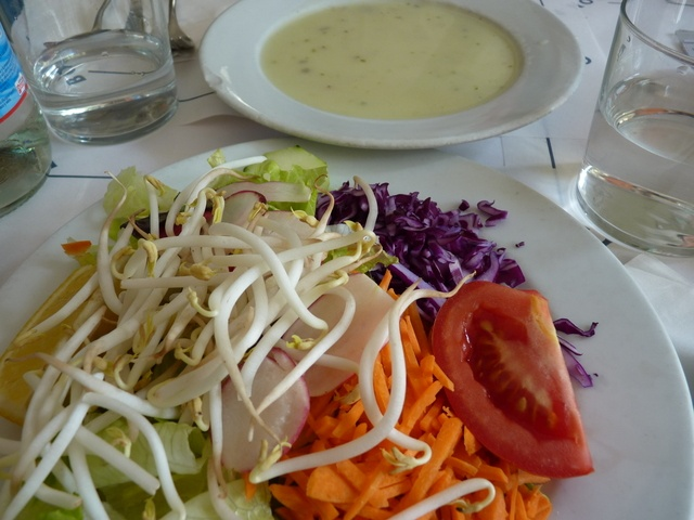 A healthy-looking salad and a bowl of creamy-looking soup.
