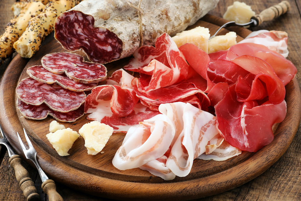 Italian snacks include platters of cured meats and cheeses