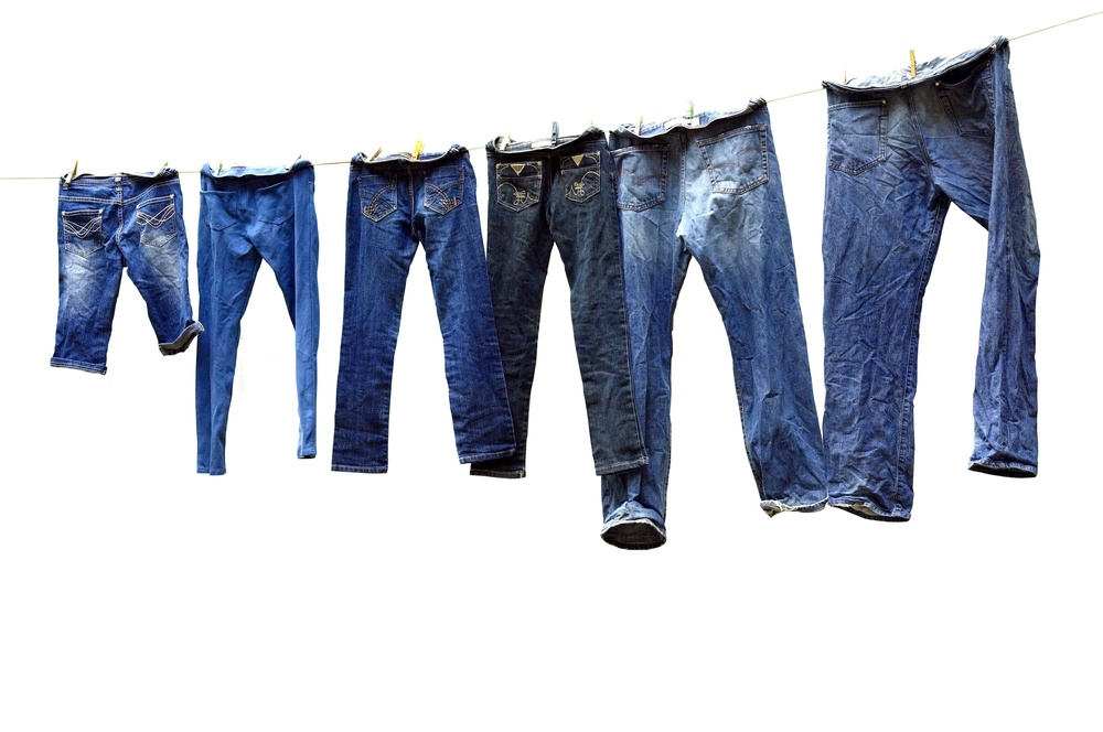 Jeans hanging from a washing line