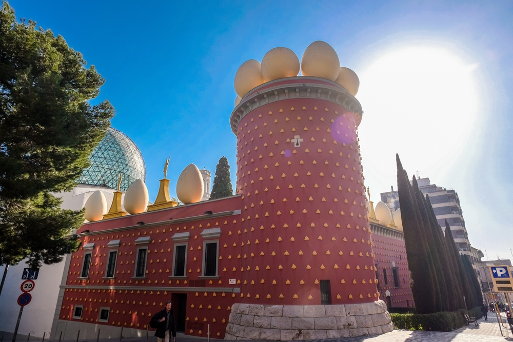 The famous red facade of Salvador Dalí's Theater Museum – an essential day trip from Barcelona in and of itself.