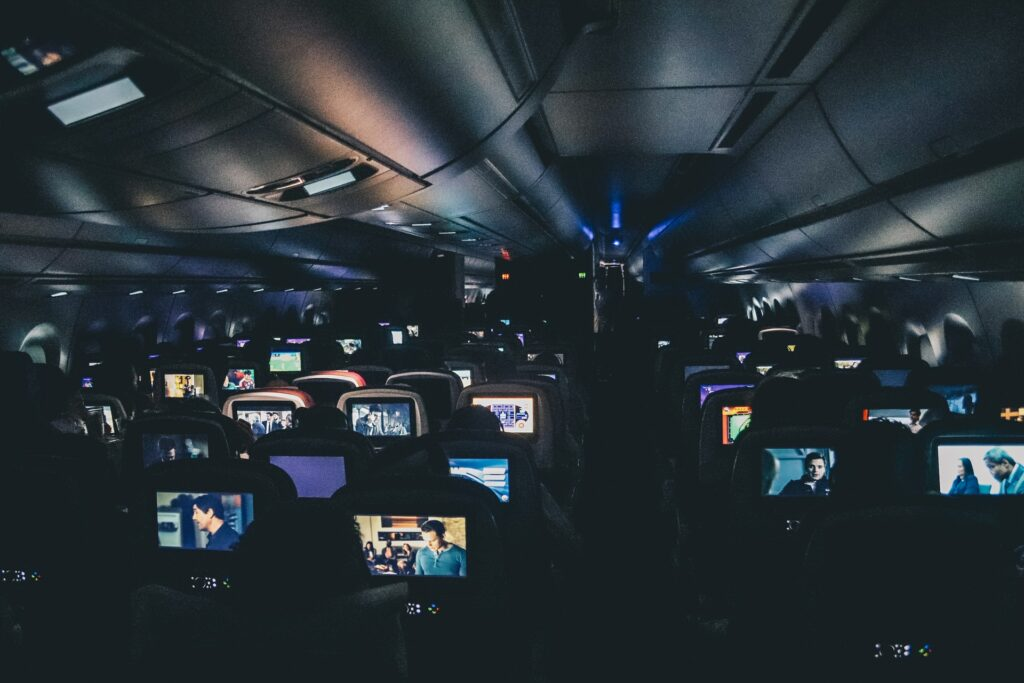 Airplane screens lit up at night