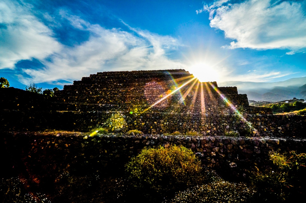 Sun sets behind the  Pyramids of Guimar in Tenerife.