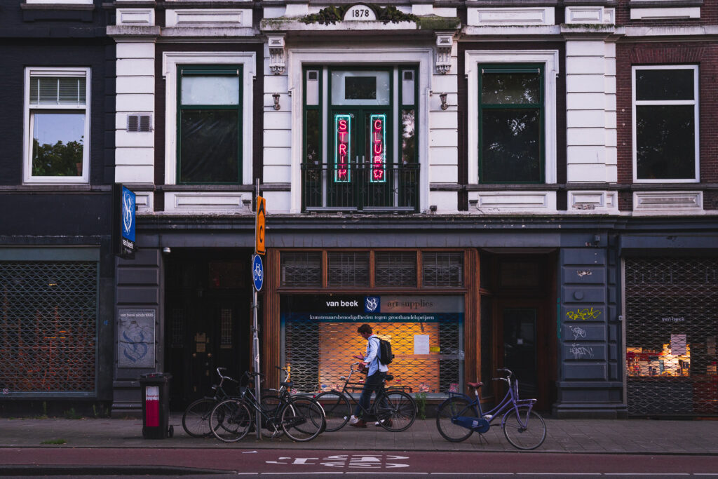 A man walks past Amsterdam Sex Club BonTon