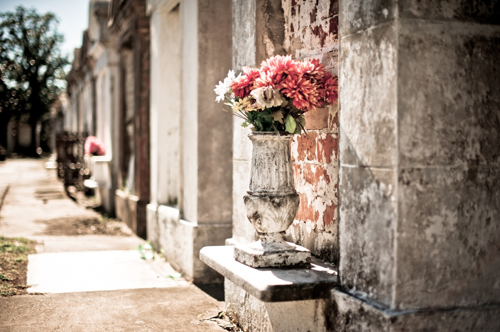 Flowers on the stoop of a vault in a New Orleans cemetery