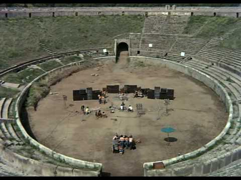 Aerial shot of Pink Floyd rocking out inside the amphitheatre of Pompeii.