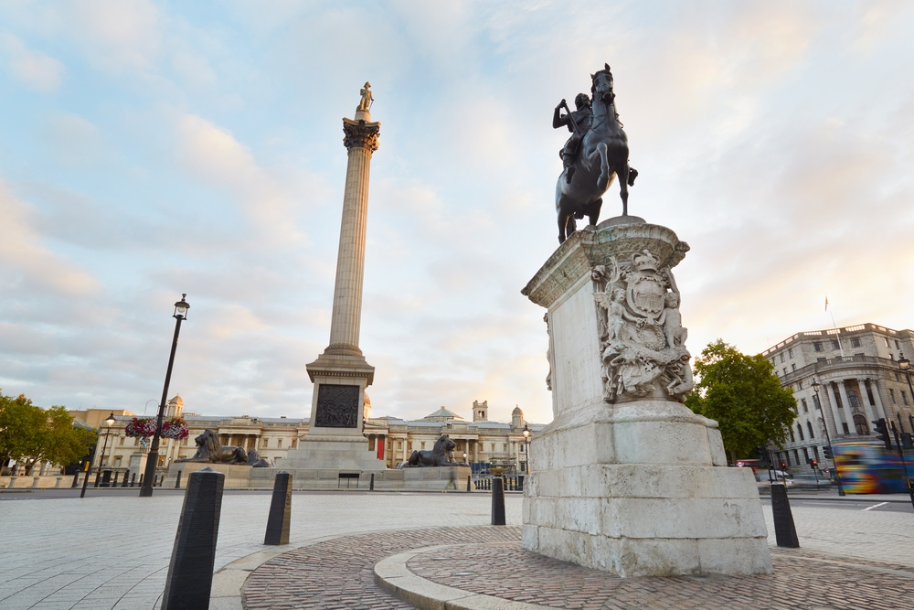 Image of Trafalgar Square, including two of its most famous monuments.