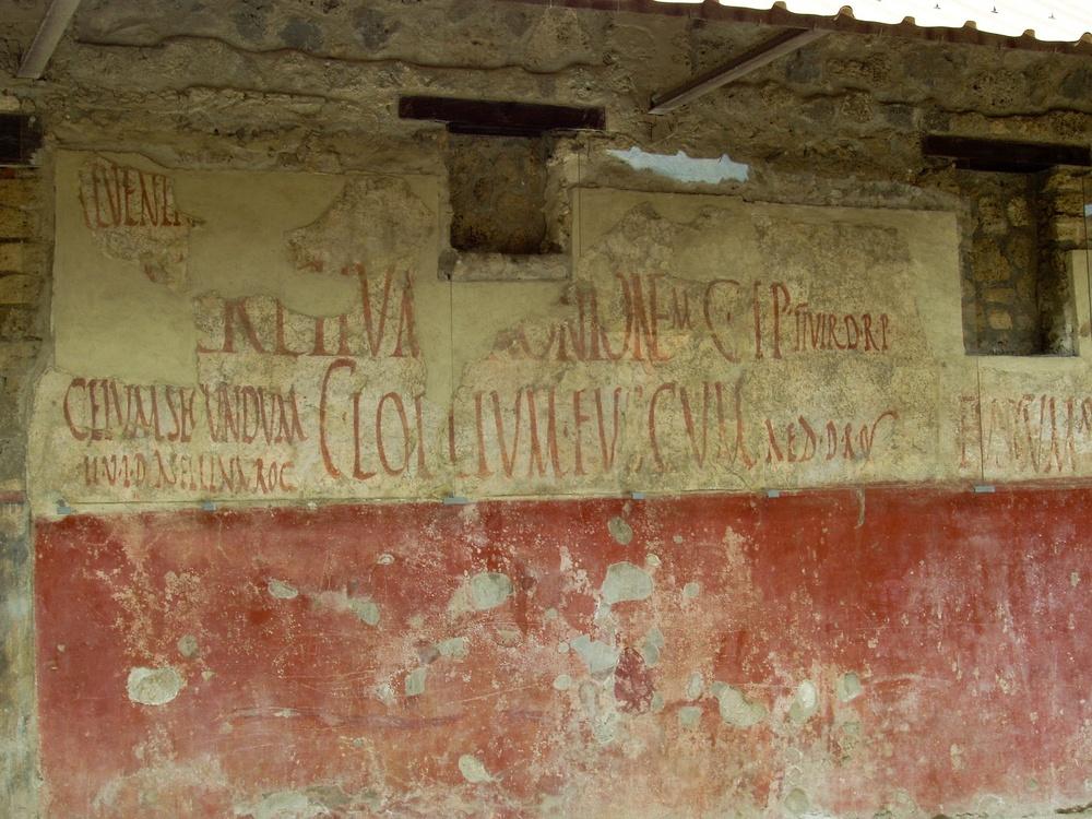 Latin graffiti emblazoned on the walls of Pompeii.