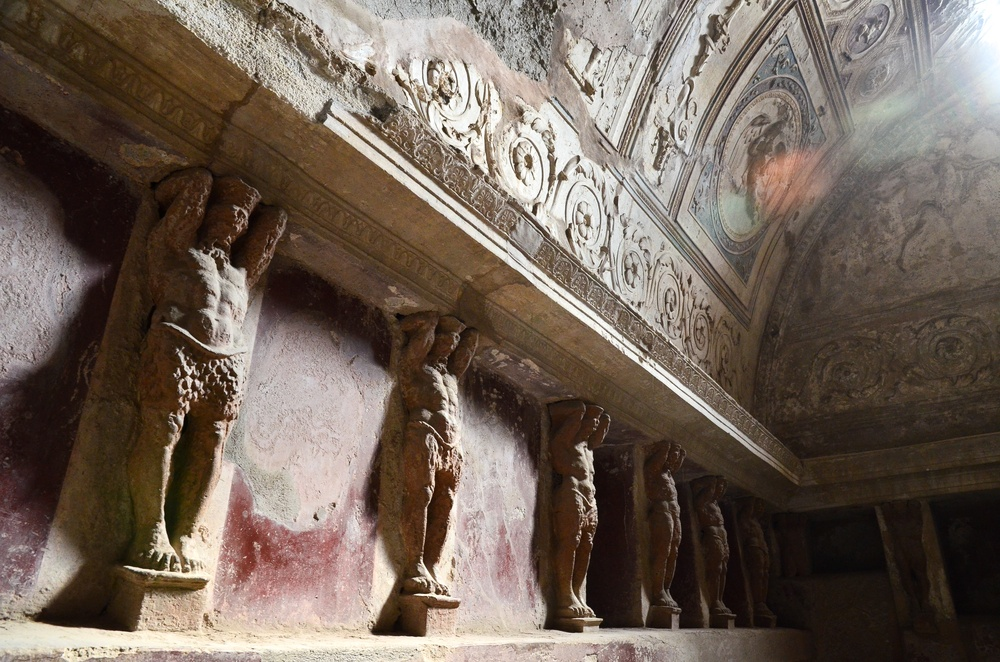 Mythological statues line the walls of Pompeii's thermal baths.
