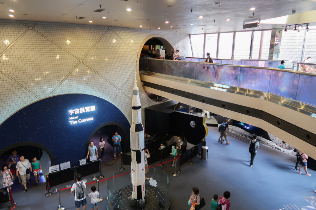Lobby space with an air bridge in the top and a space shuttle in the middle