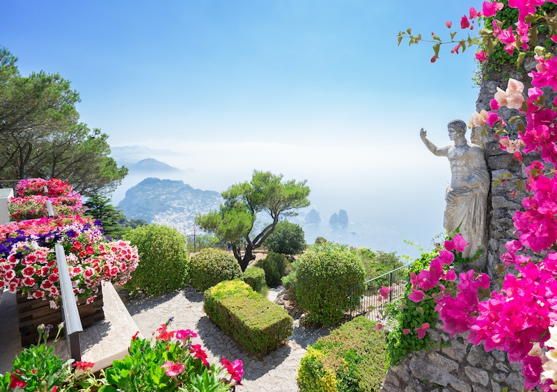 Include Capri in your Campania holidays for a bougainvillea views like this one