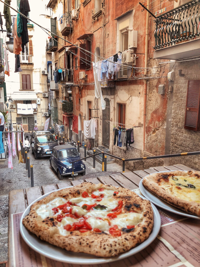 A naples city break is filled with scenes of pizza in cute alleyways.