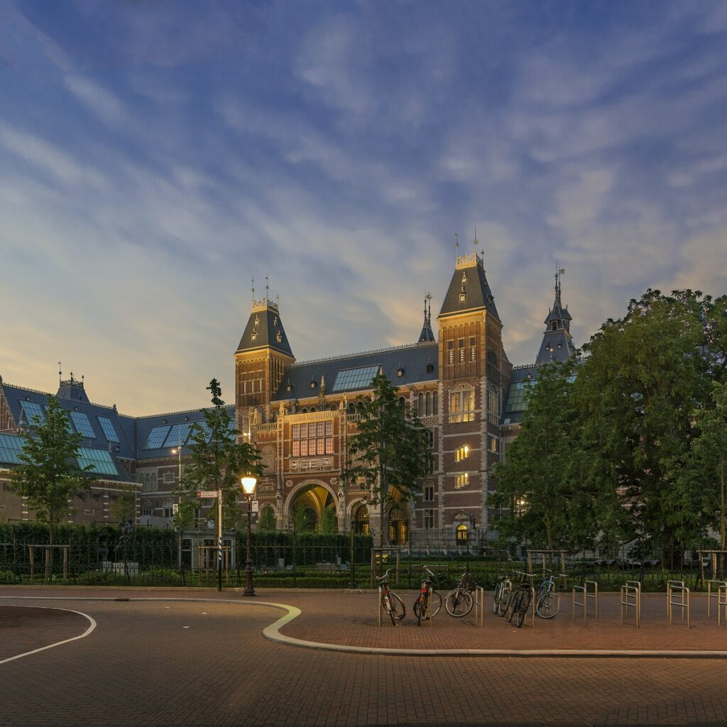 View of the outside of the Rijksmuseum in the evening.