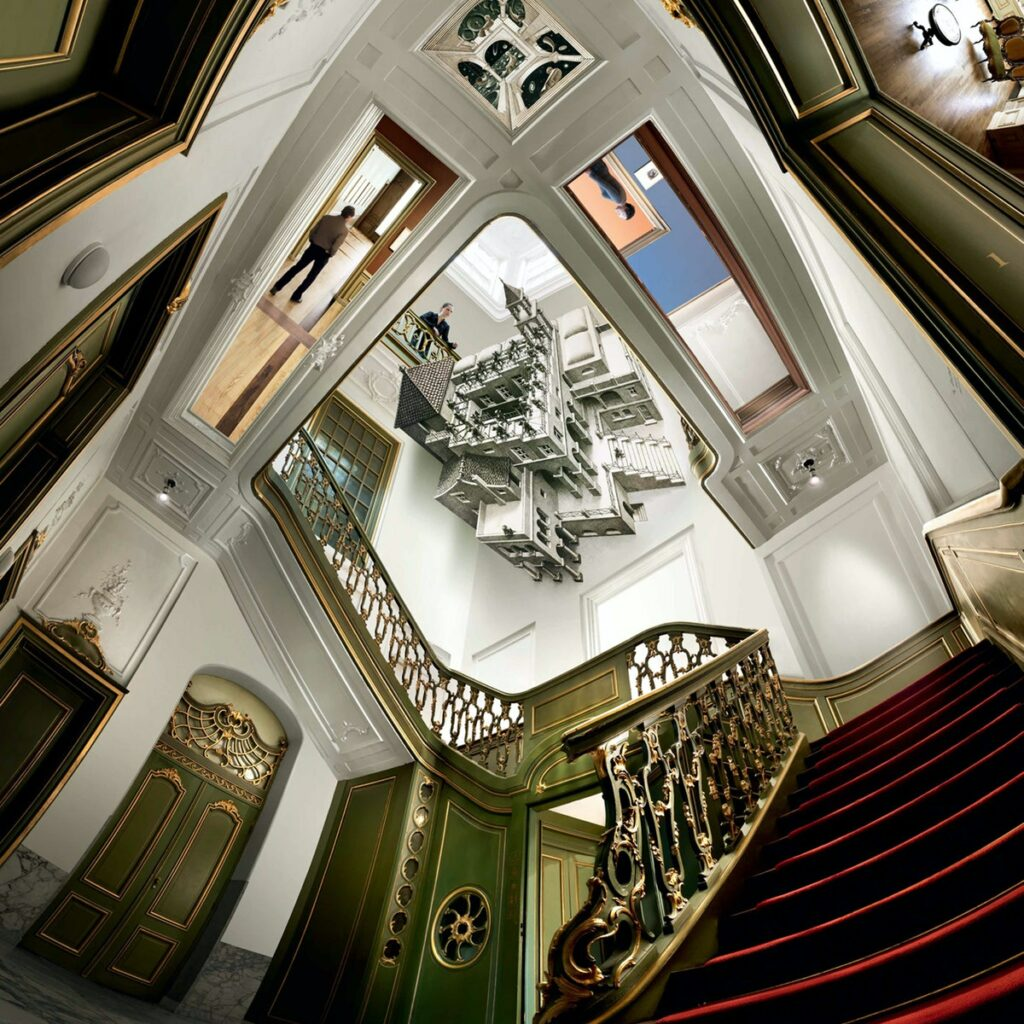 Escher Palace hallway. Optical illusion created by the painting of a castle on the museum ceiling.