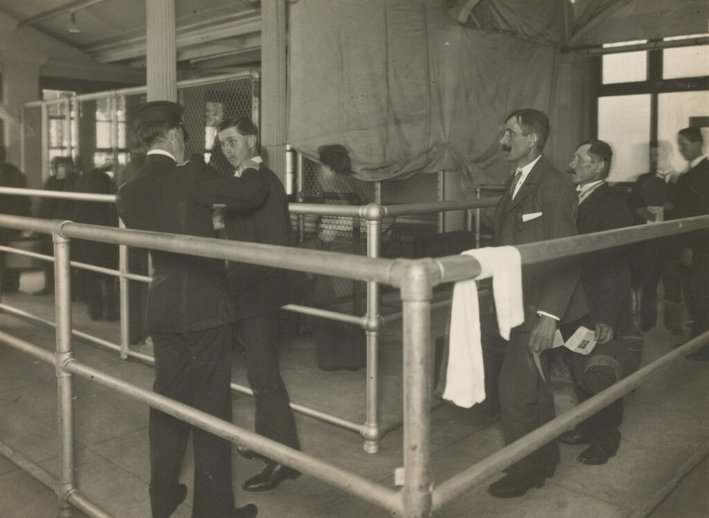 Men arriving for a health check at Ellis Island