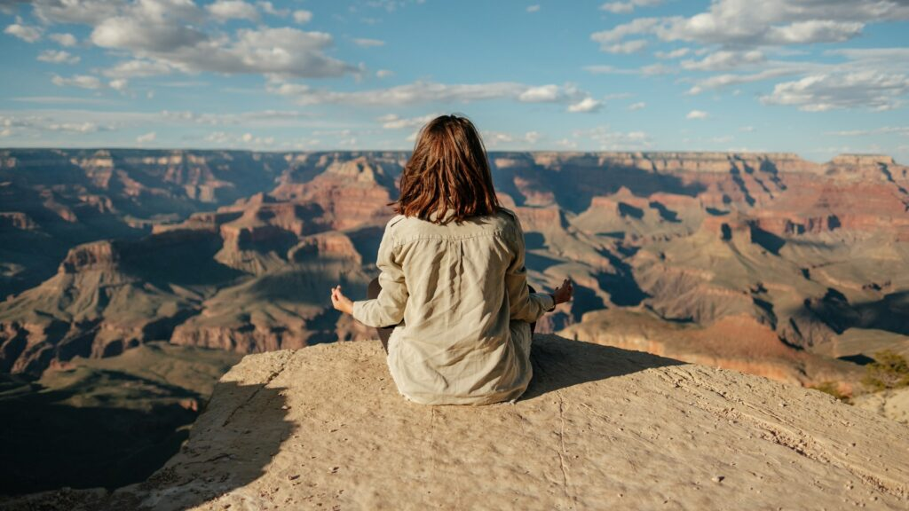 A woman doing yoga at the Grand Canyon