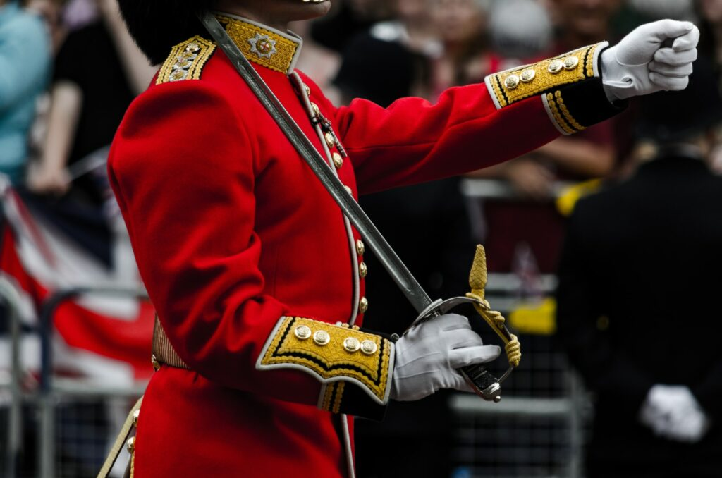 Closeup of Queen's Guard marching with saber on shoulder