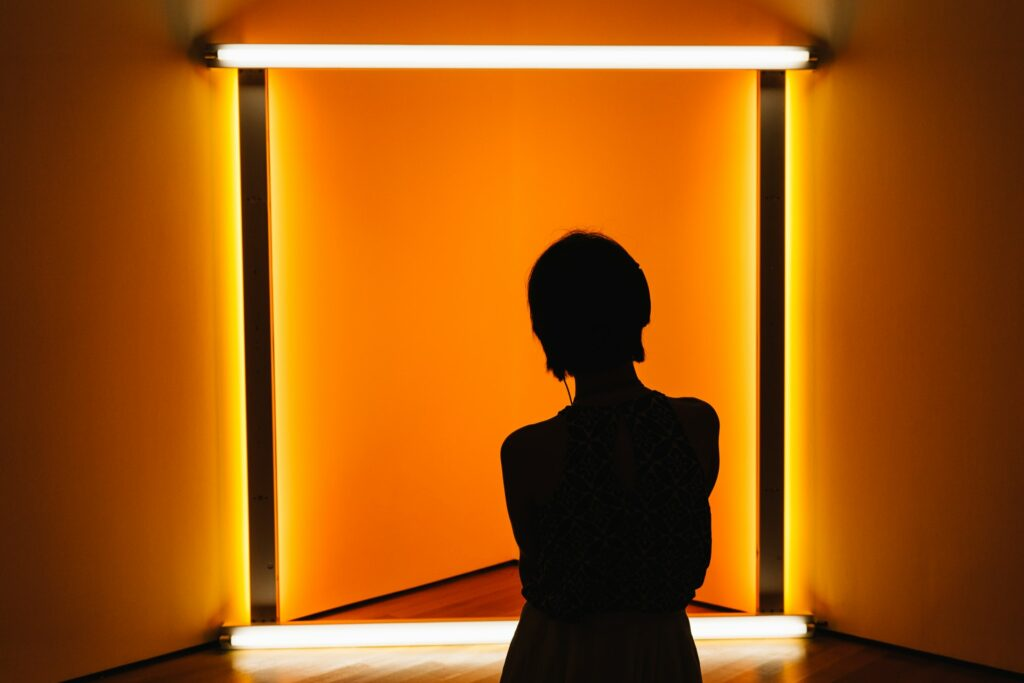 A woman admiring an installation at MOMA