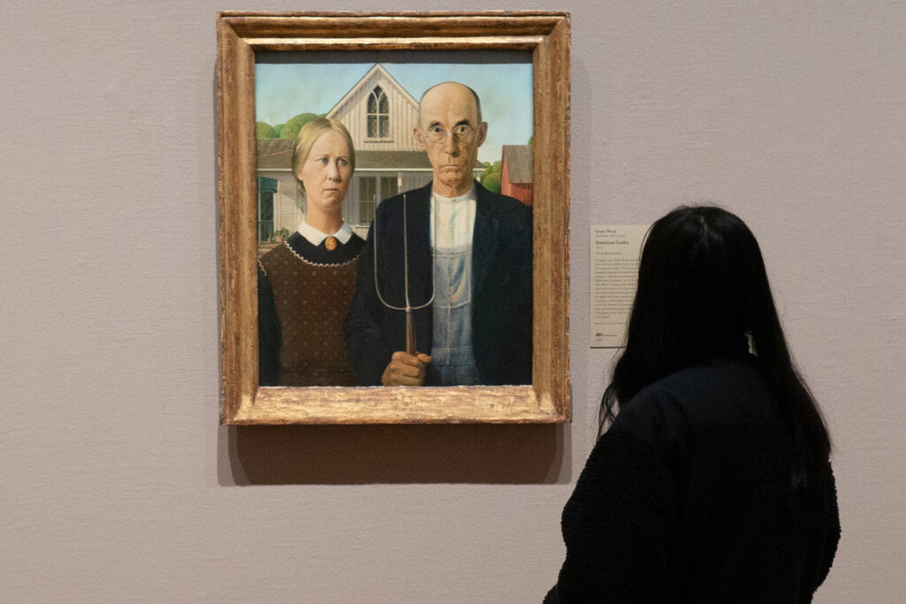 A woman admiring American Gothic at Art Institute Chicago