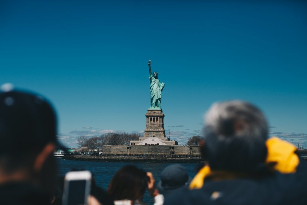 People taking photos of the Statue of Liberty