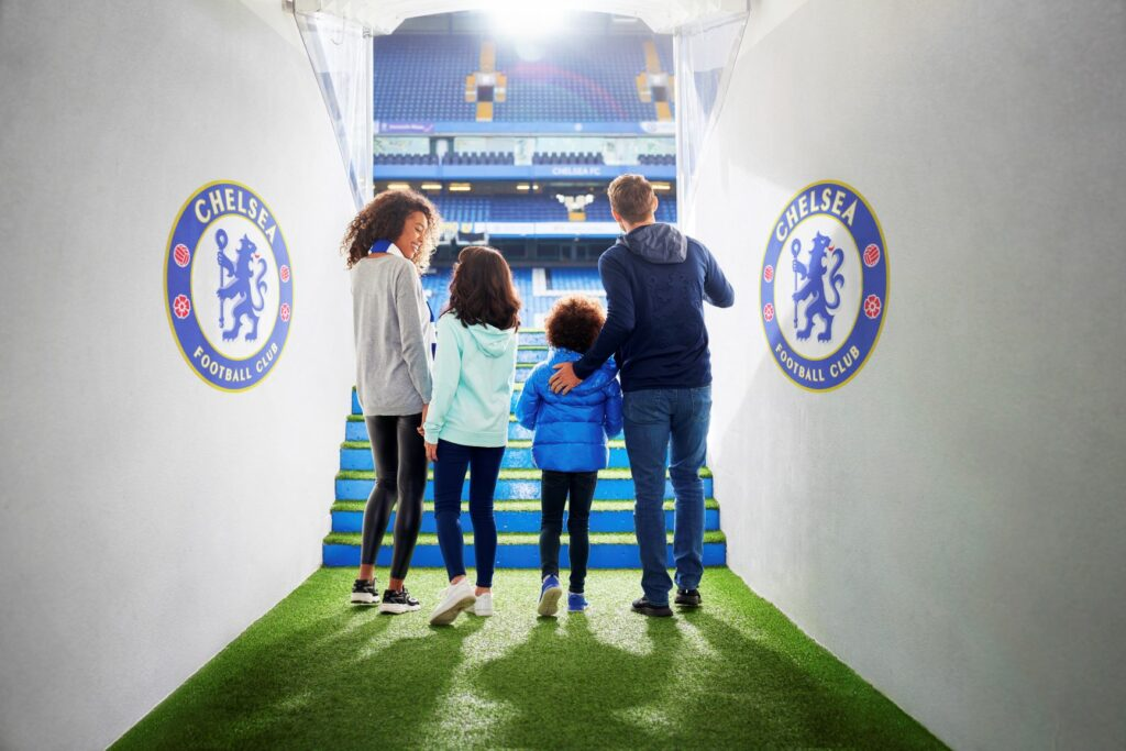 A family walks through Chelsea's player tunnel