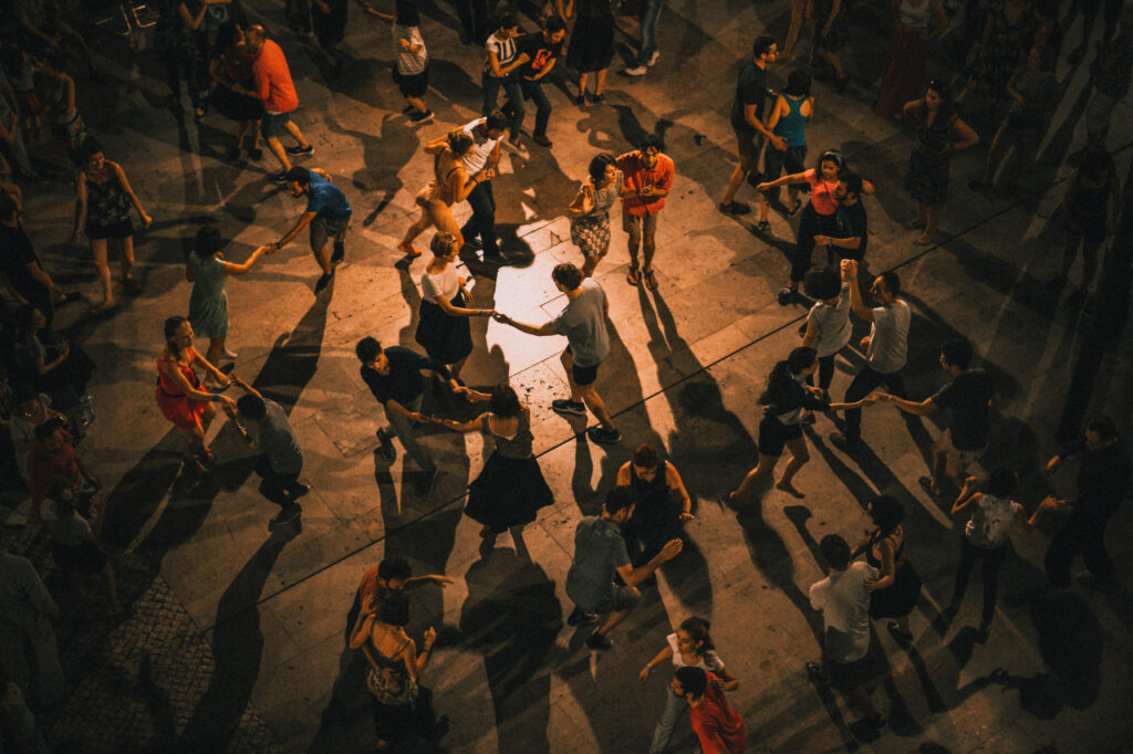 People dancing in the evening, shadows on the floor