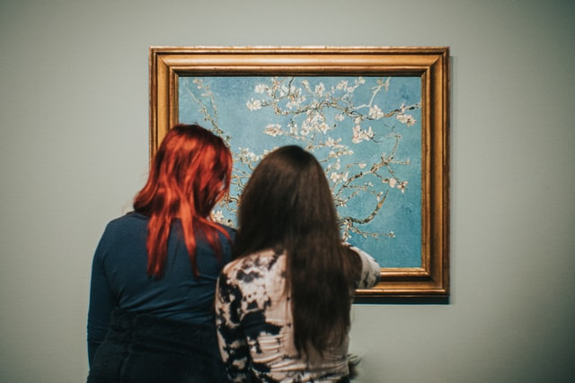 Two women look at Van Gogh's Almond Blossoms