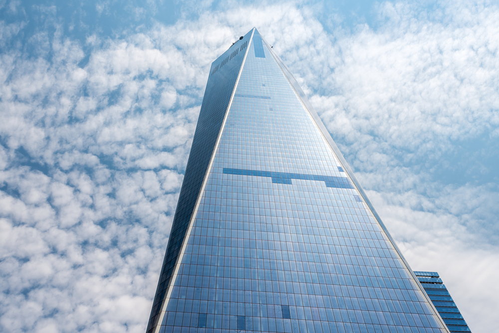 An image of One World Trade Center with blue sky in the background.