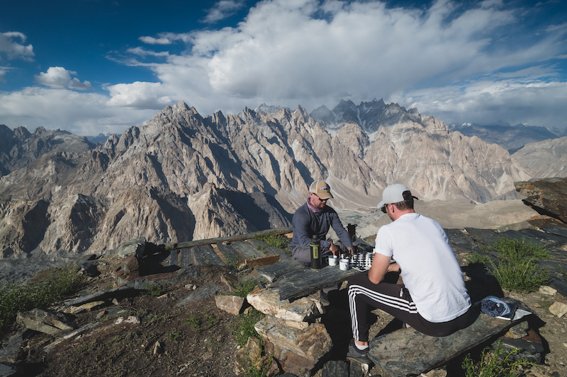Long-term travel fan Will Hatton playing chess with a friend on K2.