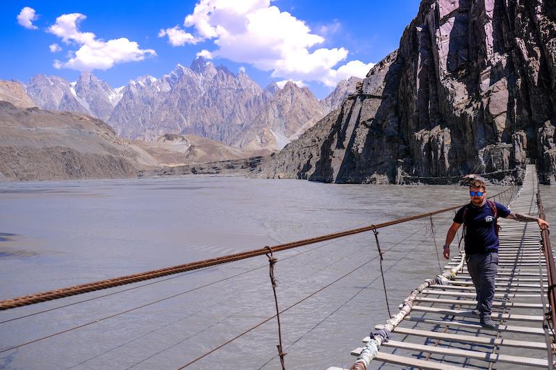 Will Hatton crossing a bridge somewhere in Asia