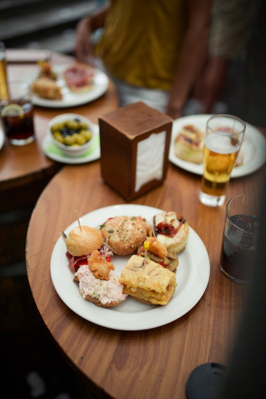 Tapas on a cafe table, food in Valencia isn't always tapas but it's great way to try lots of Valencian cuisine