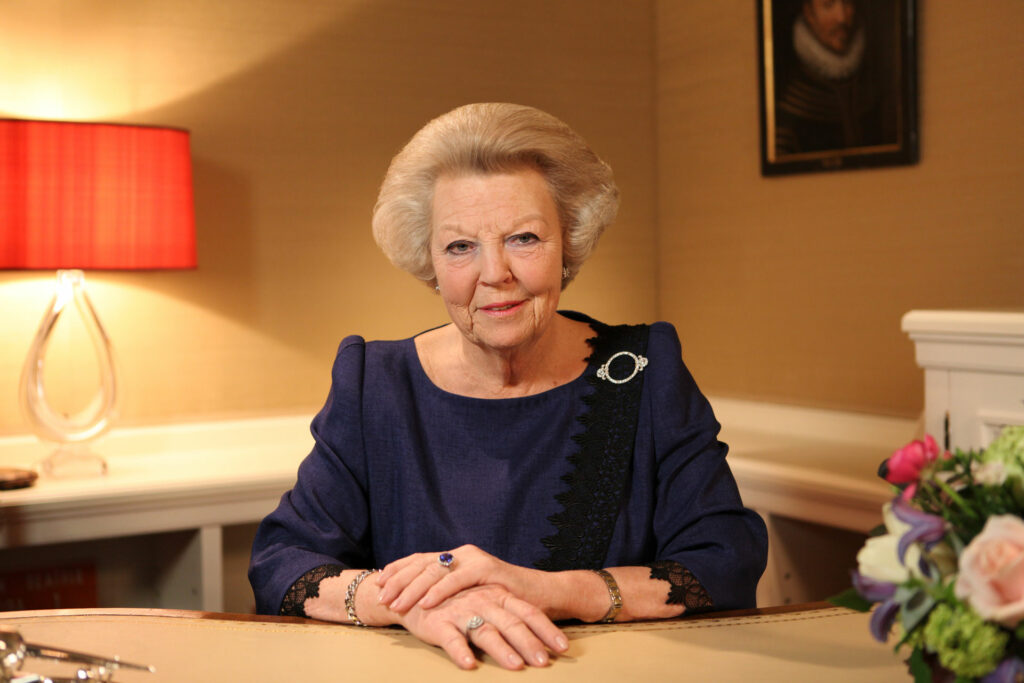 Queen Beatrix relaying to the people that she will abdicate