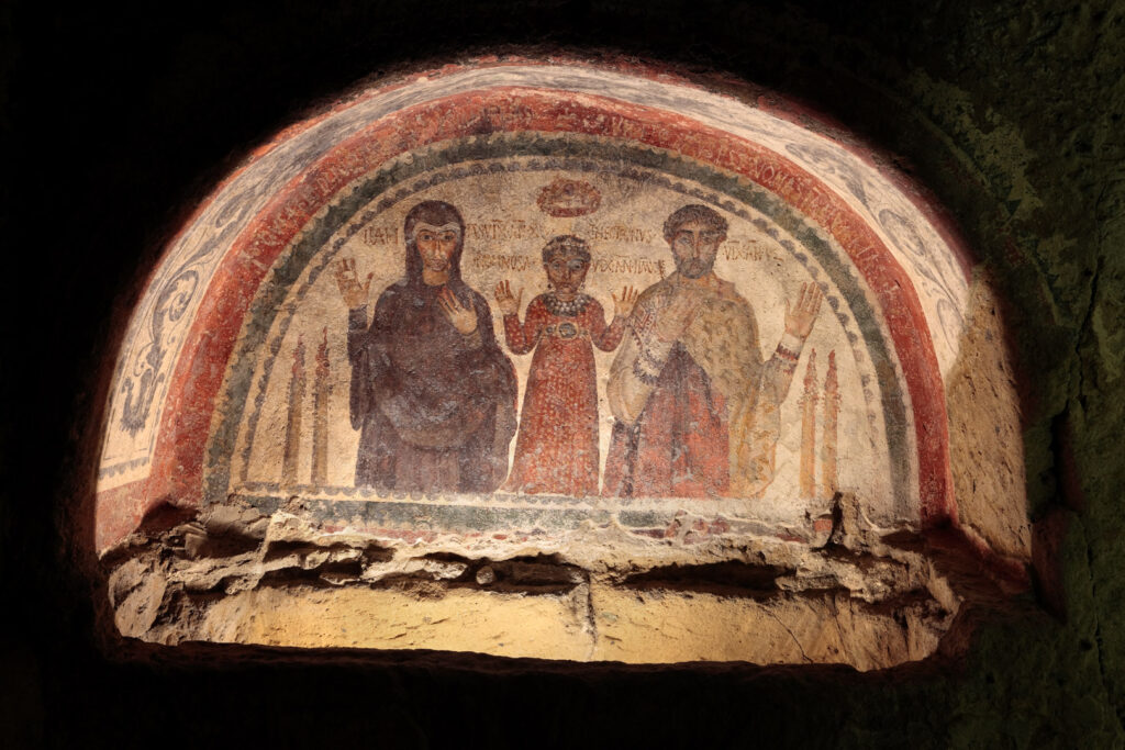 The family of Theotecnus depicted in a grave fresco inside the catacombs of San Gennaro.