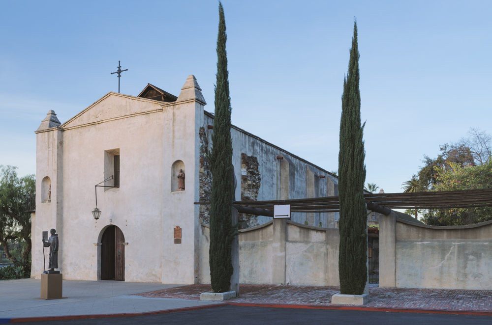 The San Gabriel Mission is a historical hidden gem in Los Angeles, featuring a statue and Spanish-influenced architecture.