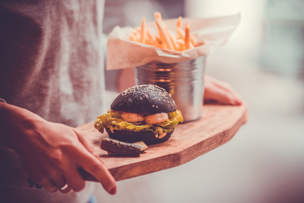 A picture of a burger dyed black with squid ink.