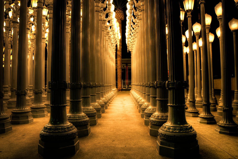 The LACMA Lights, one of the hidden artistic treasures of Los Angeles, featuring Greco-Roman columns at the base of street lamps.