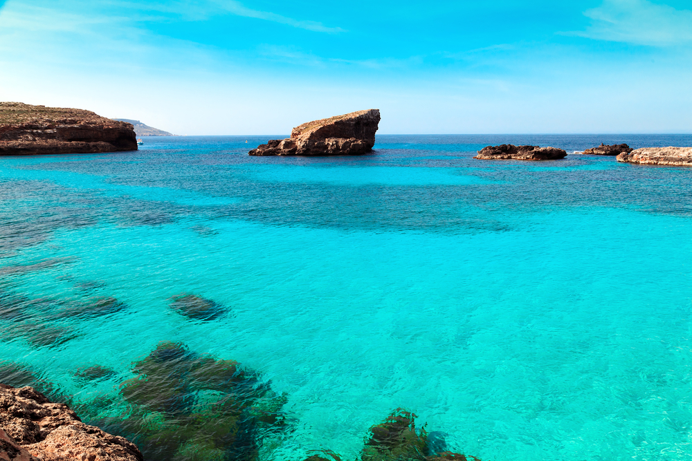 Brilliantly clear water around Comino with various shades of blue.