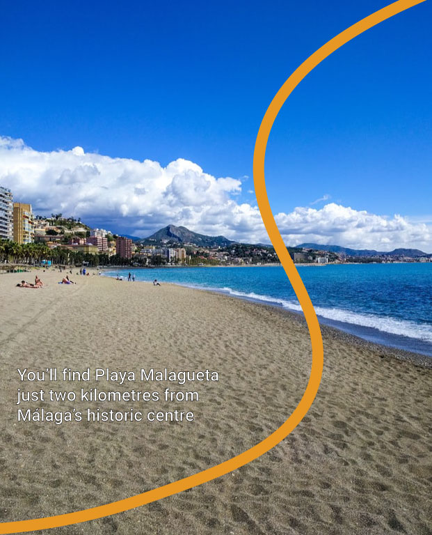 Photo of Playa Malagueta in Málaga showing mountains in the background