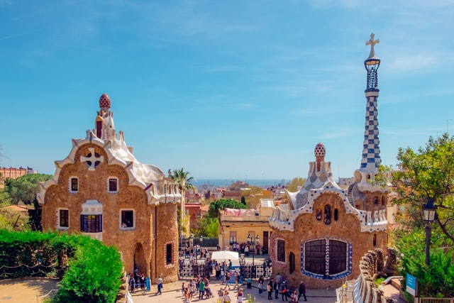 Two buildings in Park Güell during daytime