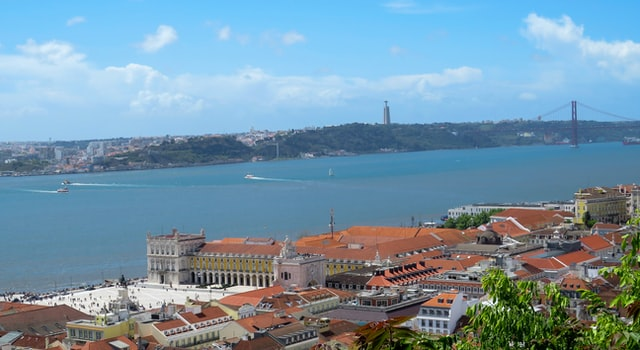 View of Lisbon's red tiled roofs with the River Tagus in the background