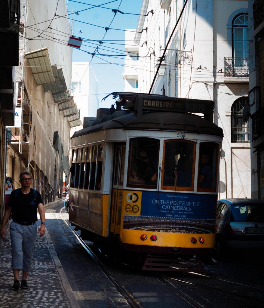 Lisbon's yellow tram 28 ascends uphill