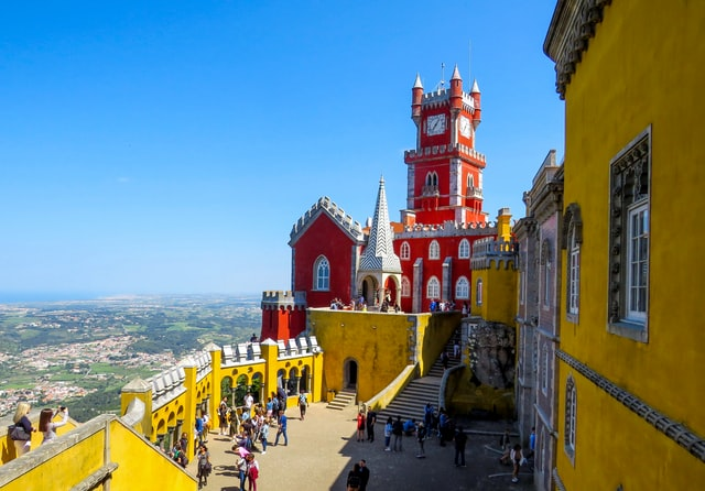 Pastel red and yellow buildings at Pena Palace in Sintra