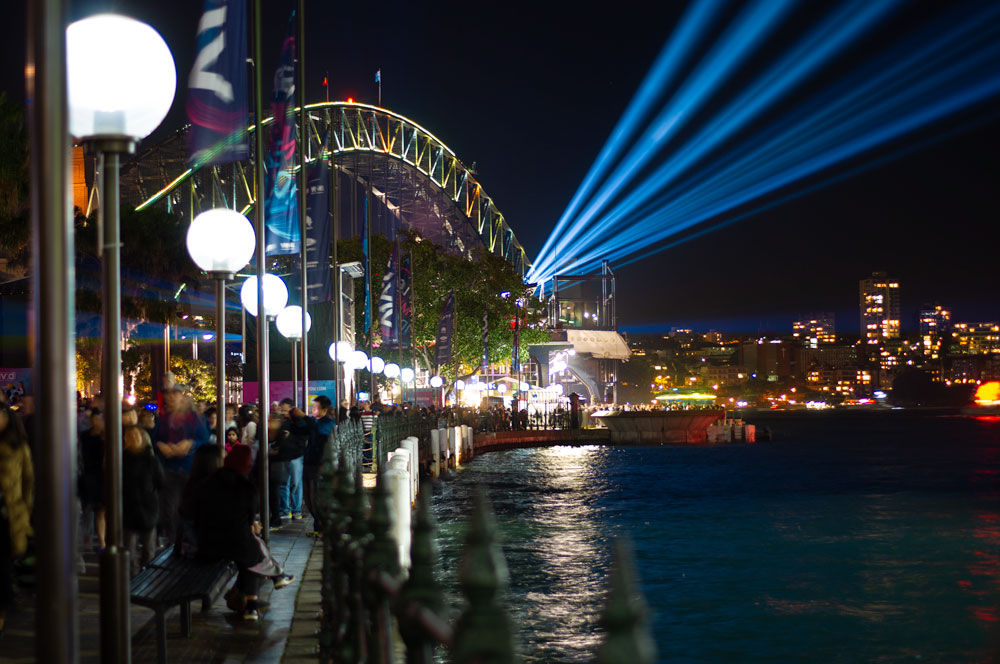 Lights shining off the Sydney Harbour Bridge during Vivid light festival
