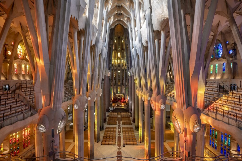 A look at the Sagrada Família's interior, featuring columns and stained glass windows.