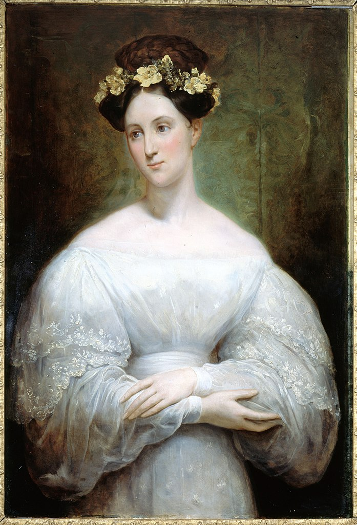 Portrait of a woman in a white dress with yellow flowers in her hair