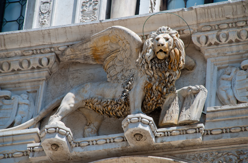 A statue of a winged lion, a famous symbol of Venice.