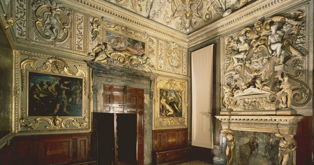 The Sala dell'Anticollegio, full of intricate decorations and paintings.